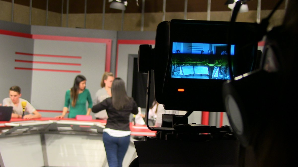 Students from Master's Degree in Communication and Education working on a TV Studio